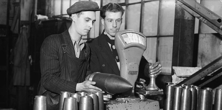 Workers weighing out shells at a munitions factory, made in accordance with the defence policy prior to World War Two -1427820